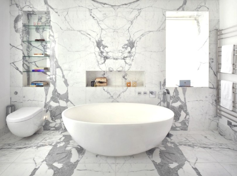 monochromatic-white-marble-bathroom-tile-designed-with-soaking-tub-also-glass-wall-shelves-decorating-idea-with-unique-bath-tub-and-an-awesome-interior-marble-stone-wall-with-great-bathroom-decoration